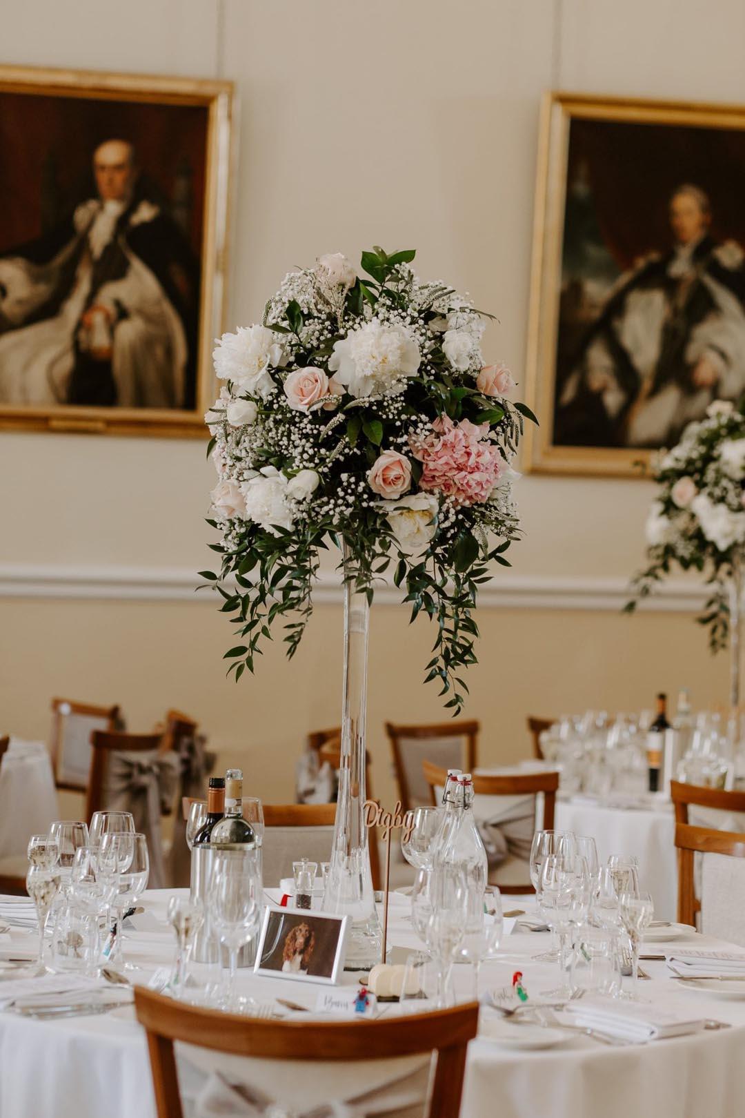 Floral wedding reception table decor at Farnham Castle