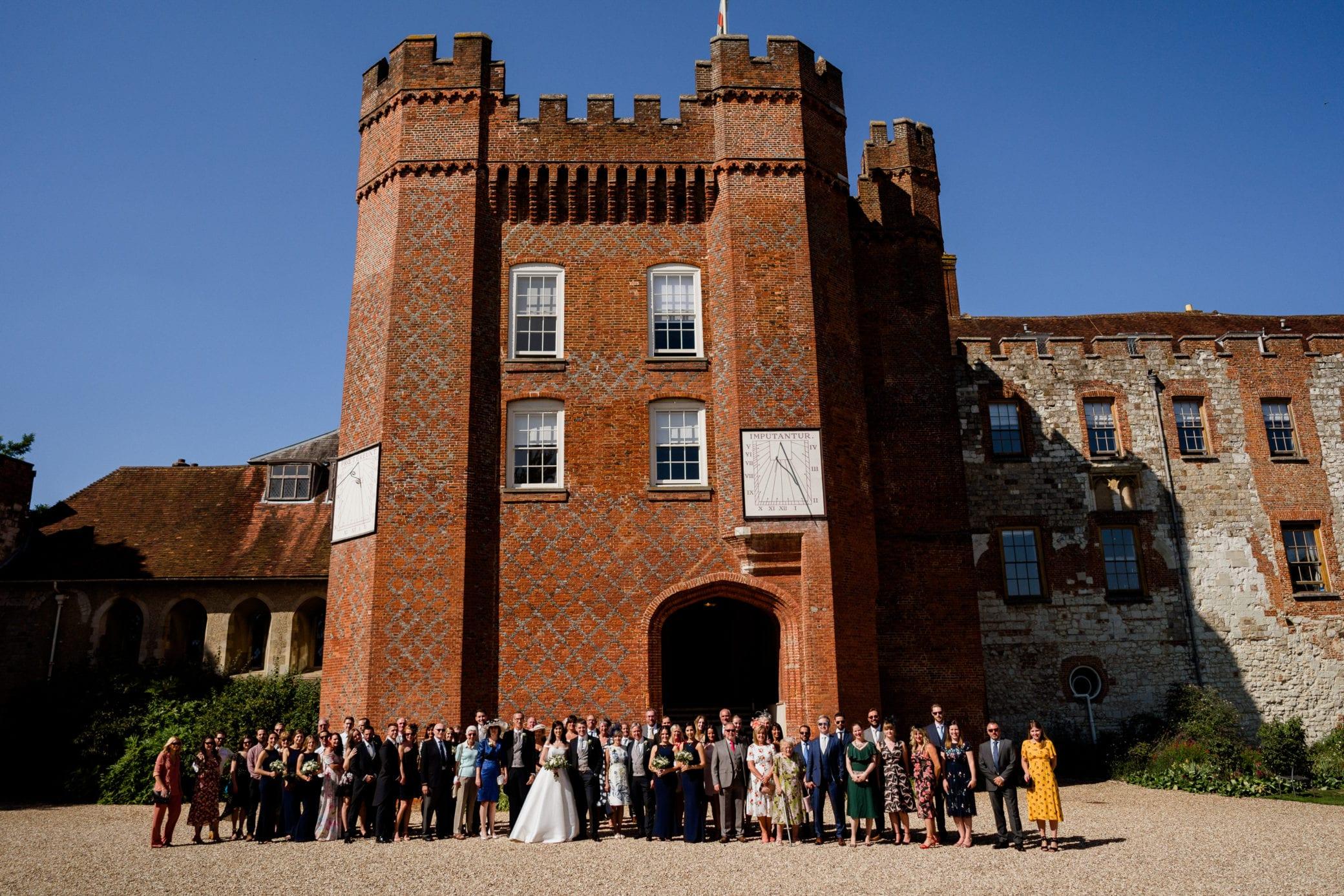 Wedding guests standing in front of Farnham Castle