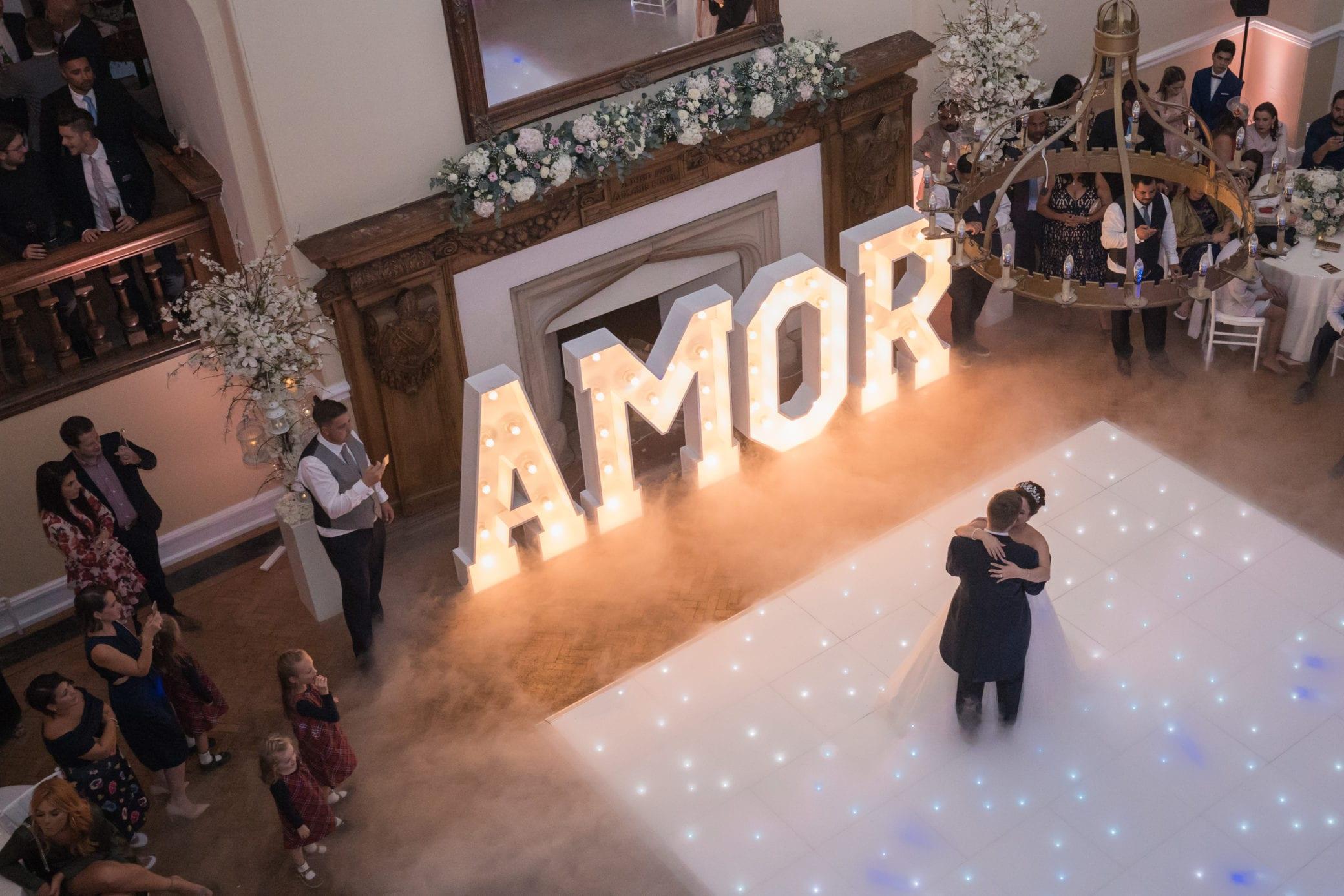 White dance floor wedding reception at Farnham Castle