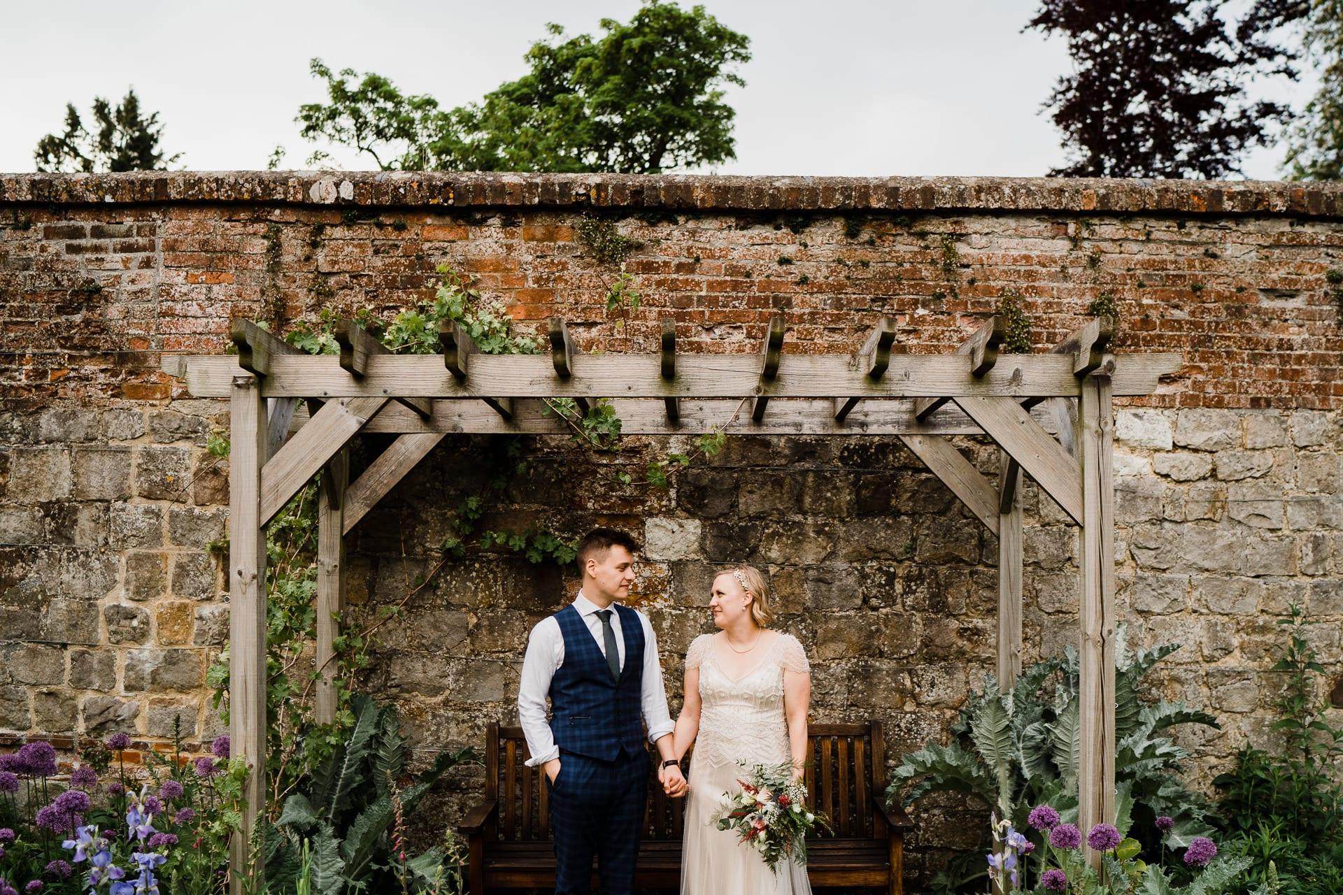 Garden wedding photography at Farnham Castle