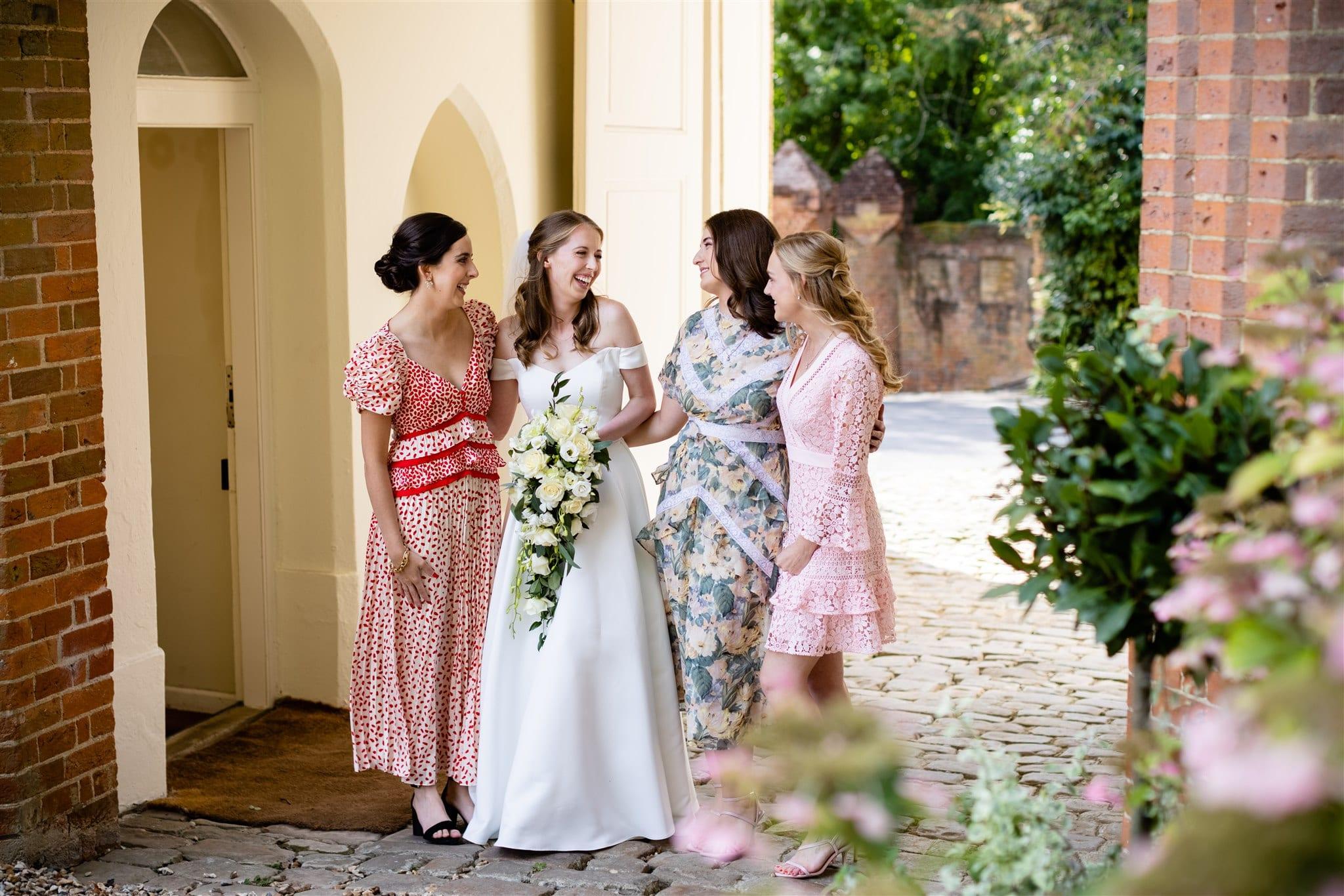 Bridesmaids wearing floral dresses at Farnham Castle in Surrey