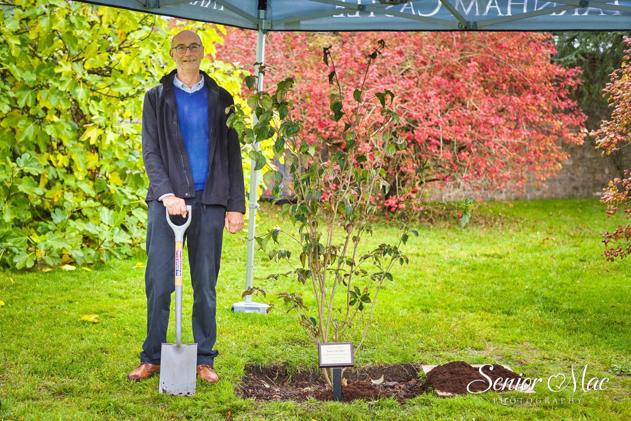 Ted Milam plants tree at Farnham Castle